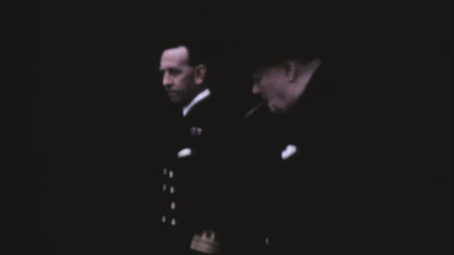 prime minister winston churchill walking with a royal navy officer while being applauded by secretaries tipping his hat while sitting in a car and... - ve day stock-videos und b-roll-filmmaterial