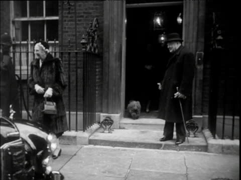 prime minister winston churchill with wife outside 10 downing street getting into car and departing chased down street by photographer dec 52 - politik und regierung stock-videos und b-roll-filmmaterial