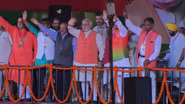 prime ministerial candidate narendra modi on stage at election rally in delhi, india - april, 2014 - political rally stock videos & royalty-free footage