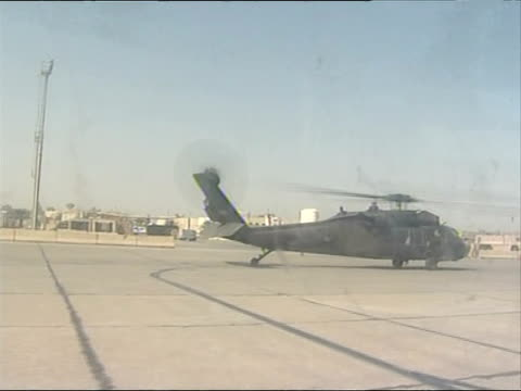 prime minster gordon brown visits troops / helicopter shots and air views iraq baghdad helicopters on ground rotors hovering at airport chinook... - helicopter rotors stock videos and b-roll footage