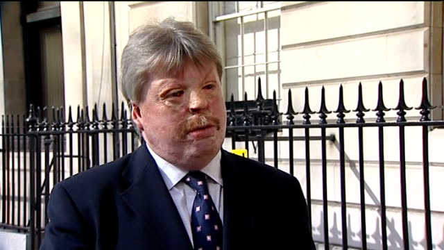 prime minster urges military to remain in uniform amidst attack fears london ext simon weston interview sot shoppers along high street vox pops war... - military uniform stock videos and b-roll footage