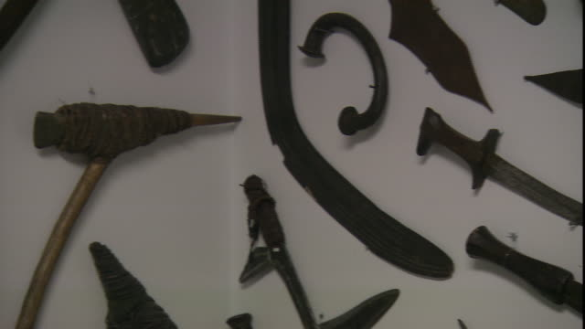 primitive weapons hang from a wall display. - dagger stock videos & royalty-free footage