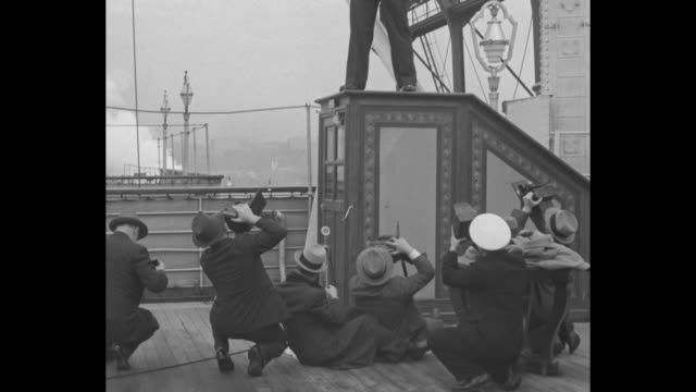 vs primo carnera poses for photographers on deck of ship / carnera answers questions stating he's been boxing for four years was a carpenter has... - primo carnera stock videos and b-roll footage