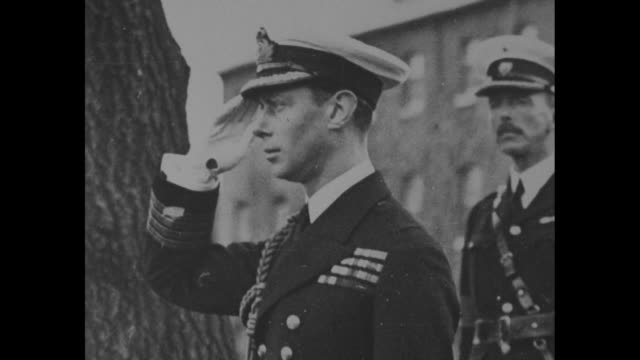 prince albert duke of york in naval admiralty uniform / simpler naval outfit / peering through a motion picture camera lens / towering bearskin hat... - george vi of the united kingdom stock videos & royalty-free footage