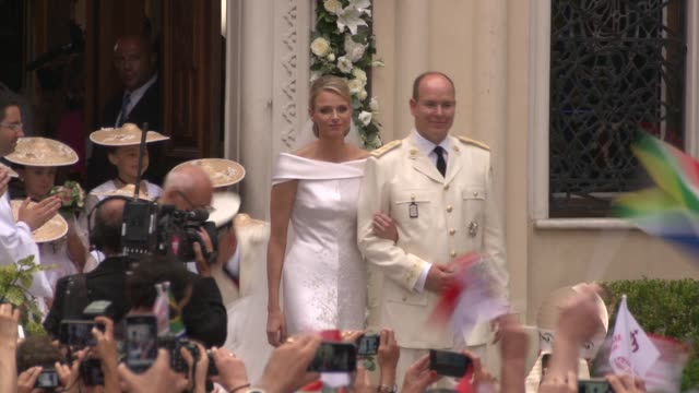prince albert ii and princess charlene of monaco at the monaco royal wedding saint devote's church appearance at monaco - monaco stock-videos und b-roll-filmmaterial