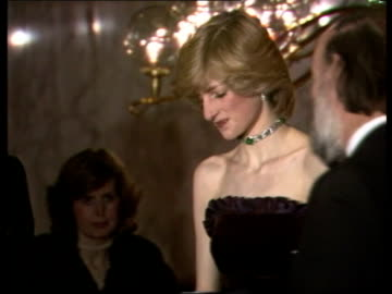 prince and princess of wales attend e.t. film premier; england: london: leicester square: empire diana, princess of wales shaking hands with stephen... - première stock videos & royalty-free footage