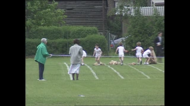 prince and princess of wales attend prince harry's sports day england london richmond wetherby school ls prince harry in sack race ls stand mothers... - sack race stock videos & royalty-free footage