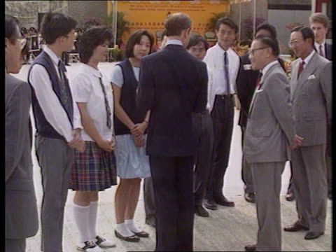 stockvideo's en b-roll-footage met hong kong visit day 2 itn diana on walkabout among families of servicemen tms gurkha women place flower garlands around diana's neck ms ditto cms... - guirlande