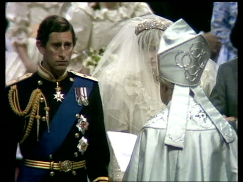 Prince and Princess of Wales' marriage INT St Paul's CMS Charles and Diana at altar on wedding day as Archbishop of Canterbury reads out wedding vows...