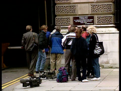 prince and princess of wales marriage / row over press intrusion ext ms group of press photographers outside treasury ms car coming out of treasury... - disrespect stock videos & royalty-free footage