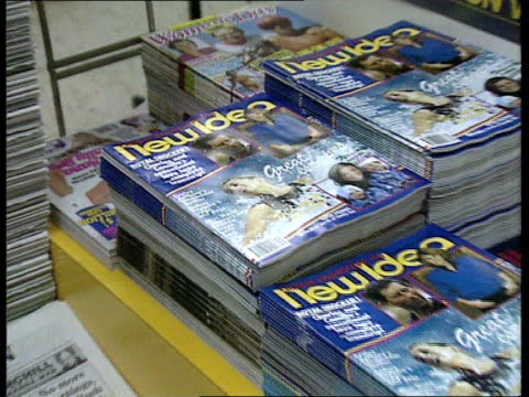 prince and princess of wales marriage / row over press intrusion; australia: int piles of new idea magazine in newsagents zoom in pages with... - disrespect stock videos & royalty-free footage
