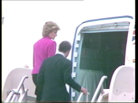 prince and princess of wales official visit: day 5; bv princess diana and prince charles up plane steps - both turn and wave and into plane - leaving... - visit stock videos & royalty-free footage