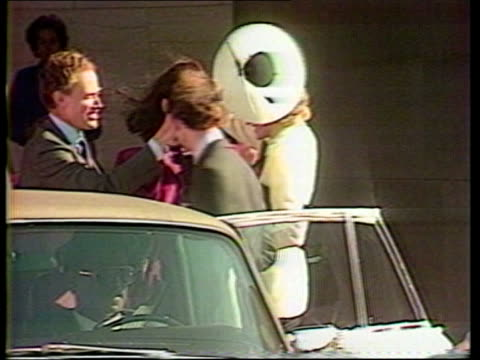 prince and princess of wales official visit: day 5; montage diana's space age hat blowing off outside national gallery freeze frame - day 5 stock videos & royalty-free footage