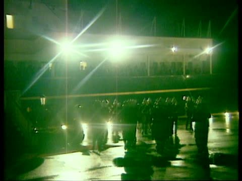 prince and princess of wales tour canada; itn night bv royal marines band play `beating the retreat' on quayside lms princess of wales with one of... - 英国海兵隊点の映像素材/bロール
