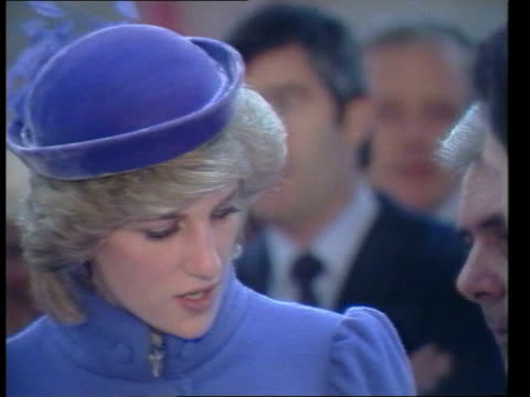 prince and princess of wales visit; england: coventry: lms princess from car and greeted cms princess wearing lilac coloured coat and matching hat... - hat stock videos & royalty-free footage