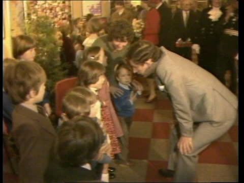 Prince and Princess of Wales visit to Wales *FIRST PORTION OF CLIP CUT OFF* Deeside BV Princess of Wales kneels to speak to children Charles speaking...