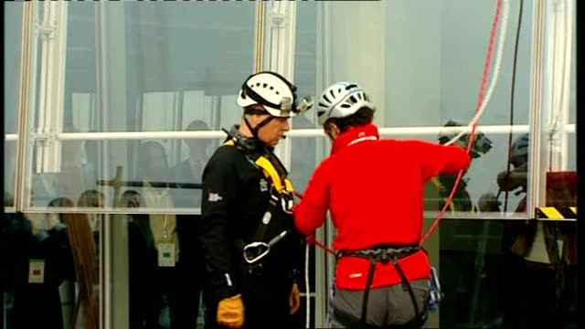 prince andrew abseils down the shard for charity prince andrew after finishing the abseil - abseiling stock videos & royalty-free footage