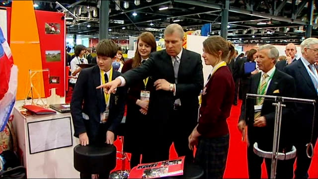 Prince Andrew attends student event at ExCel Centre in London Close up of Prince Andrew / Various of Prince Andrew discussing design project with...