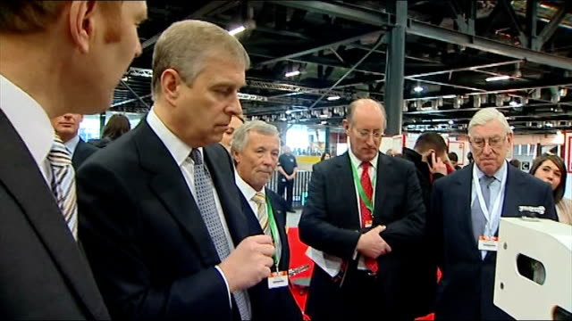 Prince Andrew attends student event at ExCel Centre in London Prince Andrew talking to student including close up of Prince Andrew / Student...