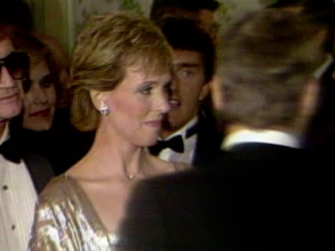 prince andrew chats to julie andrews and tom jones at a hollywood gala to raise funds for the british olympic team april 1984 - bbc stock videos & royalty-free footage