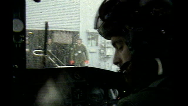 stockvideo's en b-roll-footage met prince andrew criticises bush administration on iraq war policy tx prince andrew in cockpit wearing pilot's helmet ext helicopter taking off from... - falklandeilanden