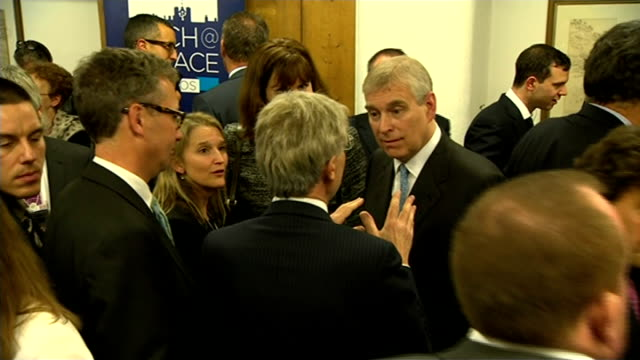 prince andrew denies 'sex abuse' allegations at world economic summit in davos switzerland davos int prince andrew smiling as chats with man at... - ダボス点の映像素材/bロール