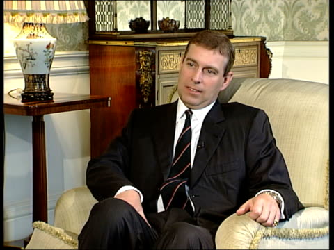 prince andrew interview on 20th anniversary of falklands war; england: london: buckingham palace: int prince andrew, duke of york into room and... - bbc stock-videos und b-roll-filmmaterial