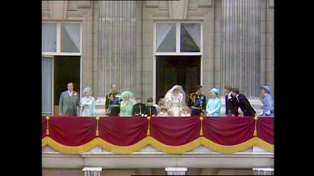 prince andrew leans over and says something to prince charles on the buckingham palace balcony on the day of the wedding of prince charles and lady... - balcony stock videos & royalty-free footage