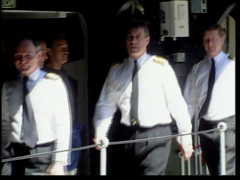 stockvideo's en b-roll-footage met prince andrew retires from the navy england north sea aircraft carrier ark royal at sea ms prince andrew duke of york along on deck with officers tgv... - militair uniform
