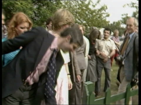 prince andrew's girlfriend:; r 26.7.81 berks: windsor: princess diana in summer dress towards with sarah l-r through crowds at polo match gathering... - windsor england stock videos & royalty-free footage