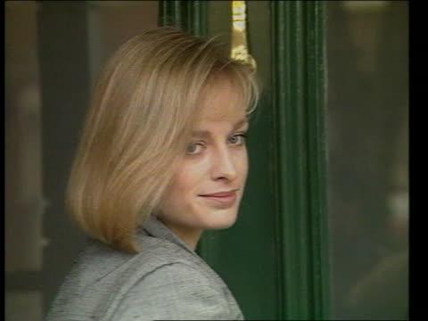 prince andrew's girlfriend:; tx 21.2.84 london: ealing: ext cms katie rabett smiling at doorway r 26.7.81 berks: windsor: cms major ronald ferguson... - girlfriend stock videos & royalty-free footage