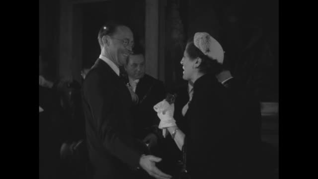 prince bernhard of the netherlands talks with woman at rome meeting of the congress of europeanamerican associations / us ambassador clare boothe... - luce stock videos & royalty-free footage