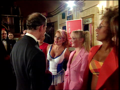 vídeos de stock e filmes b-roll de 50th birthday party/society wedding lib prince charles meeting spice girls halliwell telling the prince that she thinks he is sexy halliwell kissing... - spice girls