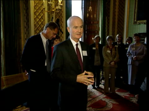 prince charles allegations/queens party lib buckingham palace sir michael peat speaking to group of people lib mail on sunday newspaper headline 'i... - palacio stock videos and b-roll footage