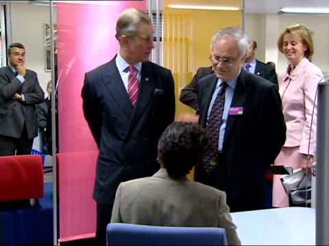 prince charles allegations/queens party pool prince charles chatting to staff member in job centre prince charles prince of wales speech sot having... - principe carlo principe del galles video stock e b–roll