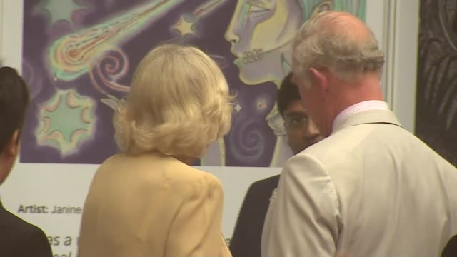 Prince Charles and Camilla arrive in New Delhi INDIA New Delhi EXT Prince Charles Prince of Wales and Camilla Duchess of Cambridge down plane steps...