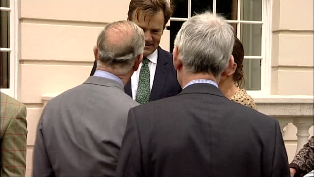 Prince Charles and Camilla attend Garden Party To Make A Difference event at Clarence House ENGLAND London Clarence House EXT Alan Titchmarsh talking...