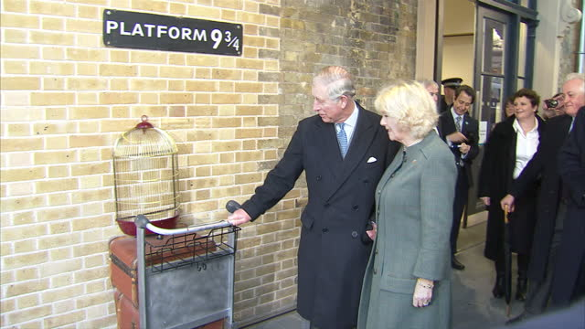 Prince Charles and Camilla Duchess of Cornwall at the Harry Potter platform 9 and 3 quarters Prince of Wales and The Duchess of Cornwall Mark the...
