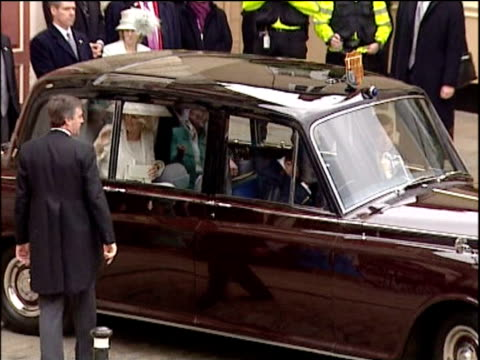 stockvideo's en b-roll-footage met prince charles and camilla duchess of cornwall leave in official car following their wedding ceremony windsor 9 apr 05 - number 9