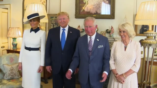 Prince Charles and Camilla Duchess of Cornwall posing for photographs with Donald and Melania Trump
