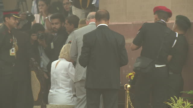Prince Charles and Camilla Duchess of Cornwall signing a book on a visit to India Gate New Delhi