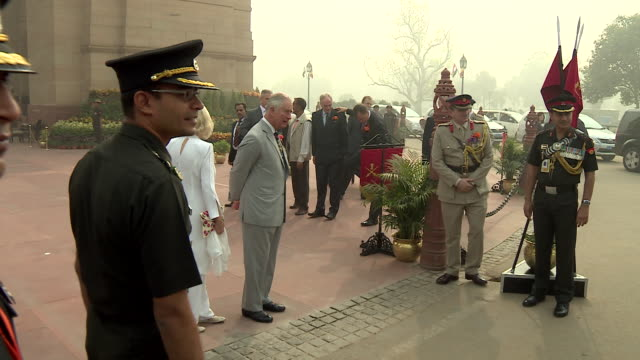 Prince Charles and Camilla Duchess of Cornwall standing outside the India Gate New Delhi