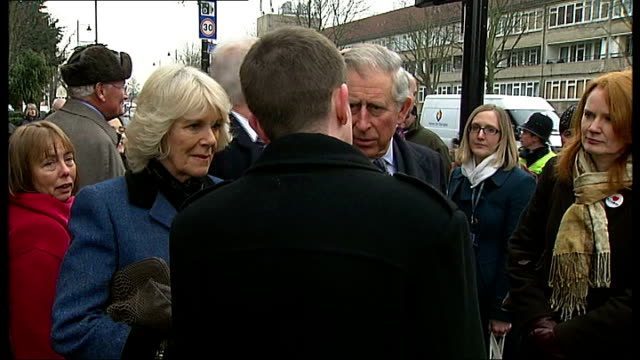 vídeos de stock, filmes e b-roll de prince charles and camilla duchess of cornwall visit to tottenham ext gvs prince charles and camilla surrounded by crowds and news crews on tottenham... - tyre