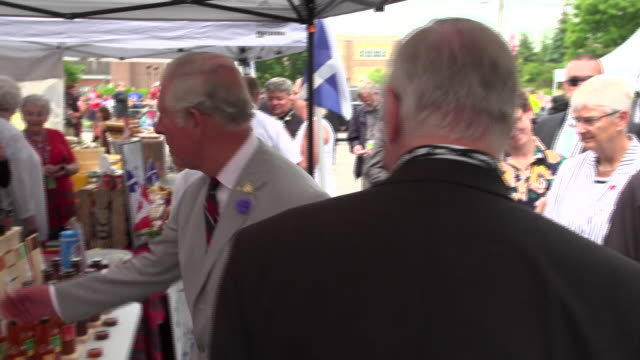 Prince Charles and Camilla Duchess of Cornwall visiting a food market and greeting crowds in Wellington Ontario during Canada's 150th birthday...
