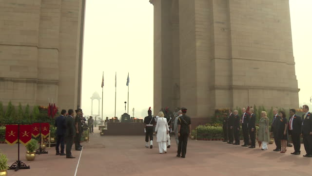 Prince Charles and Camilla Duchess of Cornwall walking towards the eternal flame at India Gate New Delhi to pay their respects