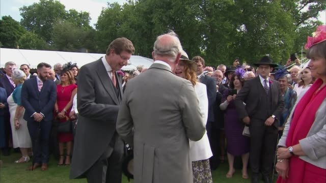Prince Charles and Camilla host garden party at Buckingham Palace ENGLAND London Buckingham Palace Prince Charles along chatting with people /...