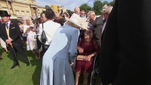 Prince Charles and Camilla host garden party at Buckingham Palace ENGLAND London Buckingham Palace Camilla Duchess of Cornwall chatting with guests...