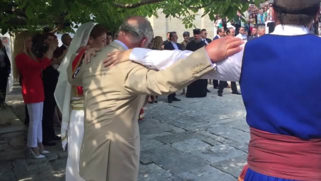 prince charles and camilla join in the traditional dancing at a celebration of local food culture and heritage in crete greece - prinz von wales stock-videos und b-roll-filmmaterial