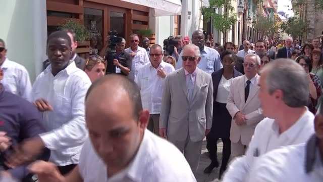 Prince Charles and Camilla make first official visit by royal family CUBA Havana EXT Prince Charles Prince of Wales towards surrounded by crowd...