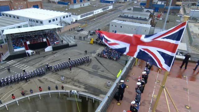 prince charles and camilla officially name the hms prince of wales aircraft carrier camilla receives flowers from children / military parade three... - ceremony stock videos and b-roll footage